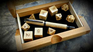 dice and pen in a Ray Jones box
